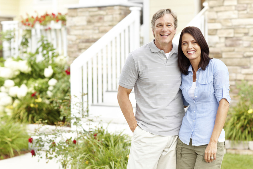 two buyers standing outside a new house